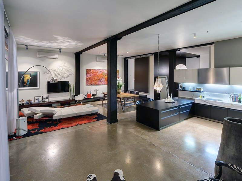 concrete-floor-with-futuristic-sofa-bed-in-breathtaking-open-kitchen-and-living-room-design-plus-floral-area-rug-with-arc-f