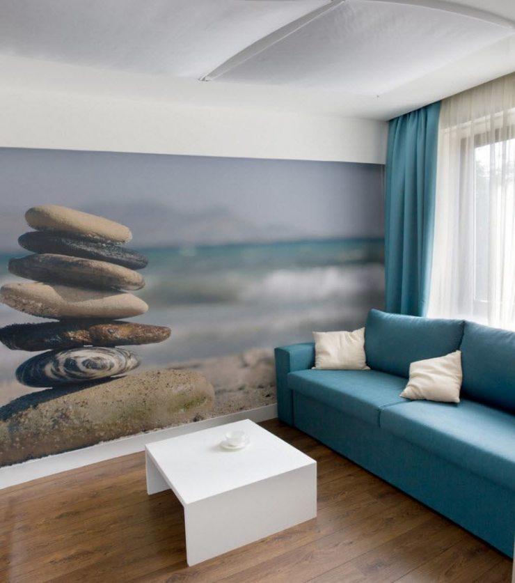 Фотообои с изображением морских камней и побережья в гостиной