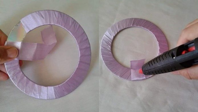 Обклеивание трафарета из диска атласной тесьмой
