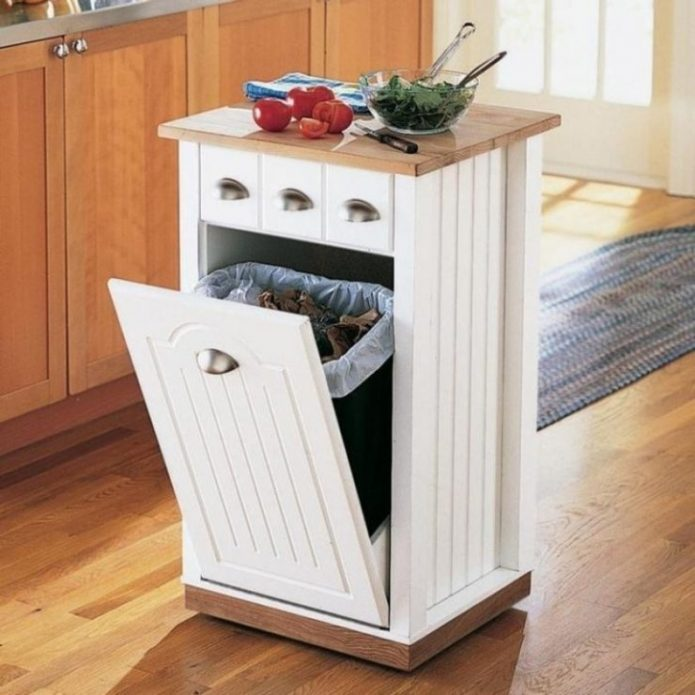Шкаф-остров на кухне с мусорным ведром