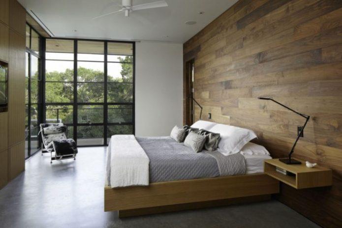 Отделка стен ламинатом в интерьере спальни
