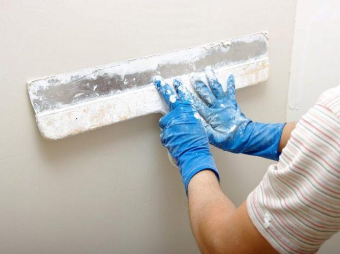 Подготовка стены к укладке ламината на клей