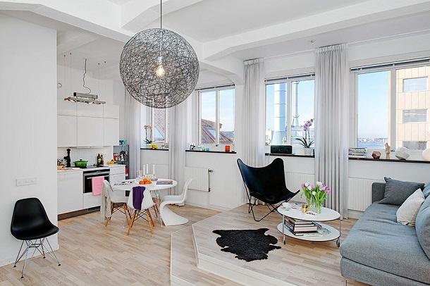 Разделение кухни и гостиной подиумом